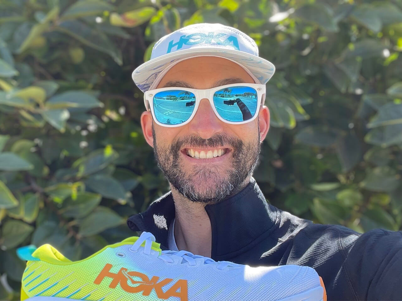 Senior HOKA® Footwear Product Developer, Ryan Ritzau holding a Bondi X shoe