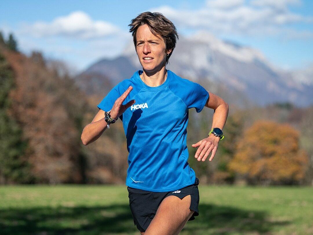 Audrey wearing HOKA shirt in blue running
