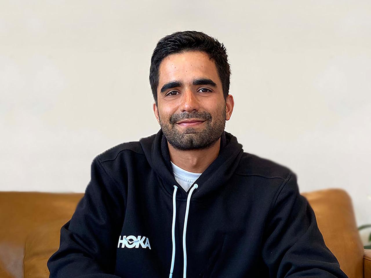Gabe Nicasio smiling wearing HOKA