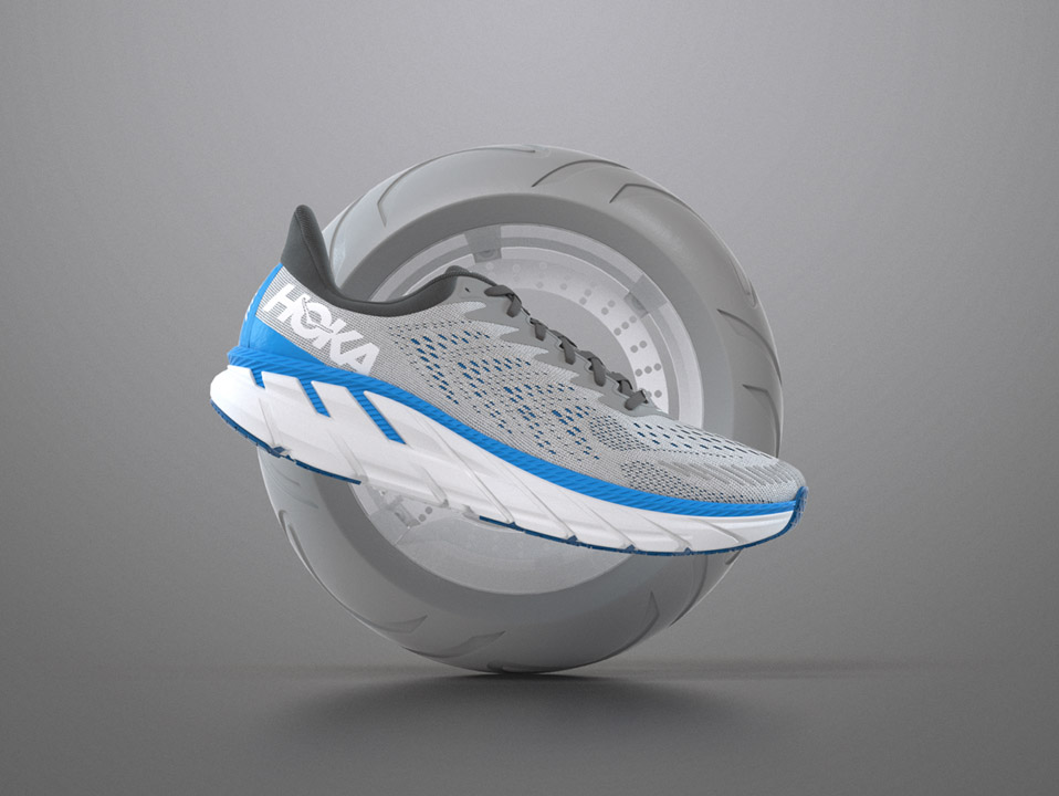 An image of a hoka shoe in front of a tire