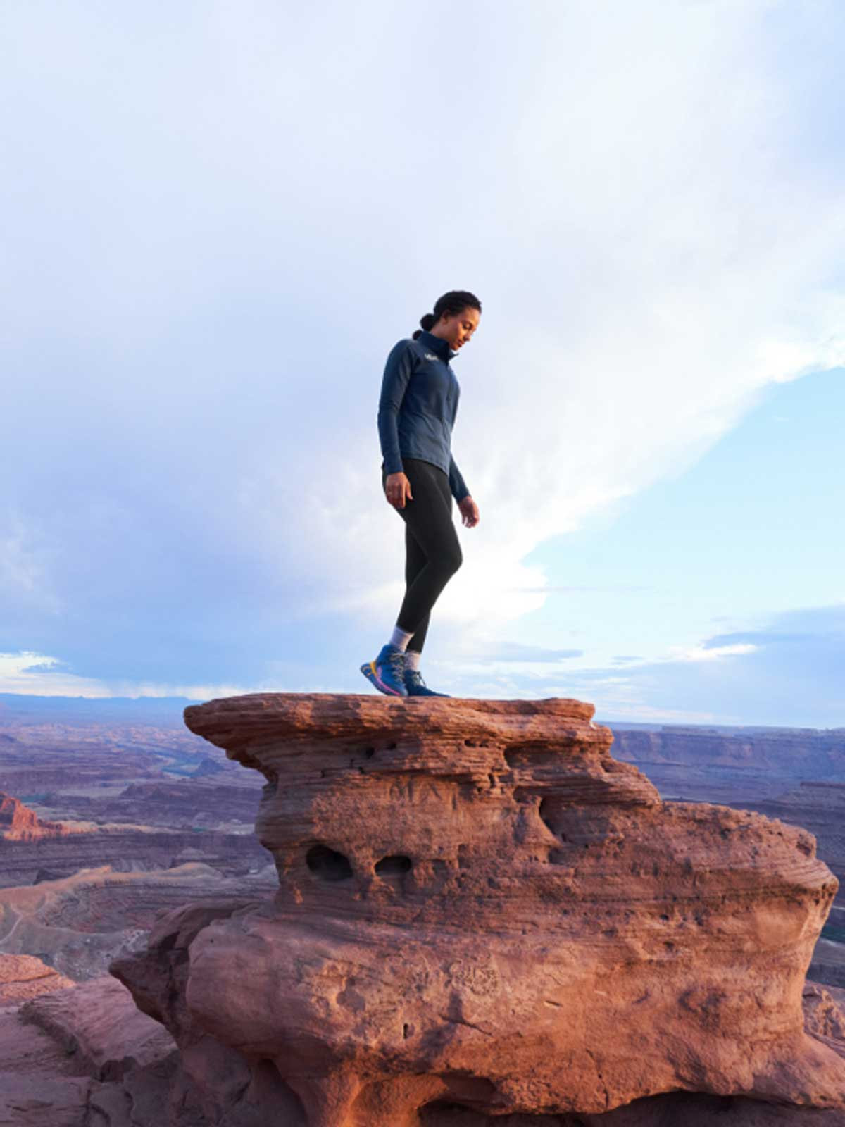 A woman standing on red rocks