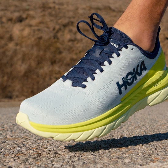 Close up of someone putting on HOKA Clifton 7 shoes
