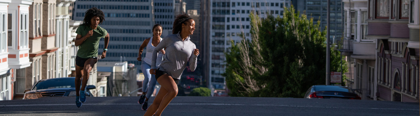 Three people jogging down the streets of San Francisco.