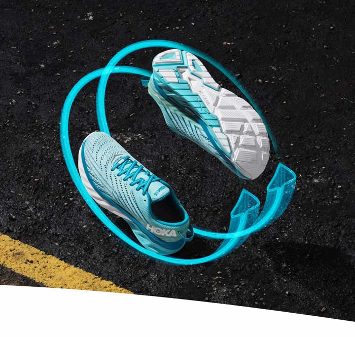 The HOKA Arahi 4 seen from the top and bottom with arrow graphics hovering over a street.