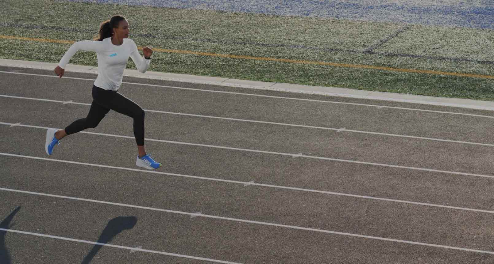 A woman sprinting on a track