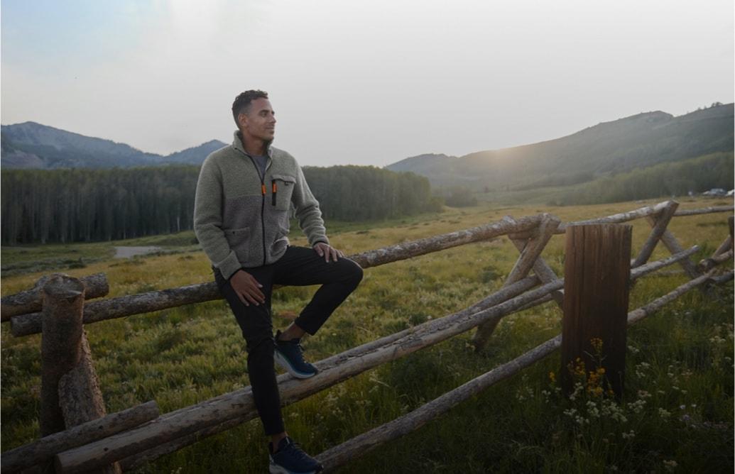 A man sitting on a fence