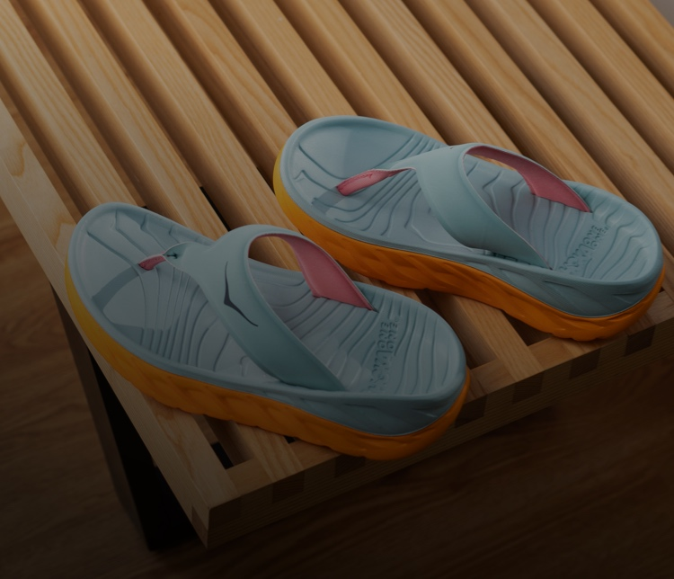 A picture of HOKA recovery sandals ontop of a table