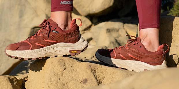 Woman standing in Hoka hiking shoes