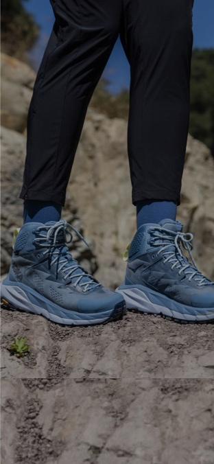 A woman hiking in HOKAs