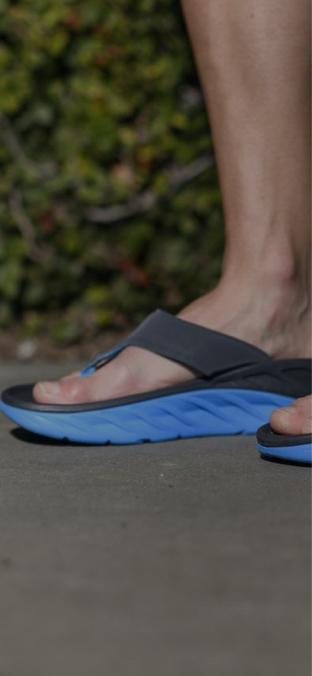 A man standing in HOKA sandals